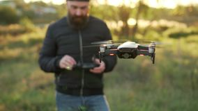 Man controls drones in vicinity of himself