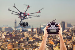 Man controls the flying drones. In the hands of a professional radio control mules. Remote radio control copter in the young man's hands. Management of royalty free stock images