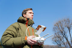 Man controls the flying drones. In the spring stock photo