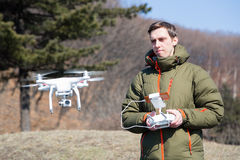 Man controls the flying drones. Spring royalty free stock photo