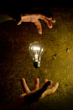 Man controls the light bulb Royalty Free Stock Photography