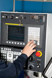 Man controls of a machine CNC Royalty Free Stock Photography