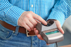 Man controls payment terminal Stock Photography