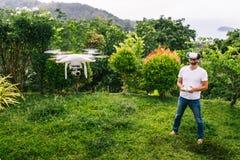 Man controls a quadrocopter. Stock Photos