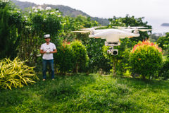 Man controls a quadrocopter. Royalty Free Stock Images