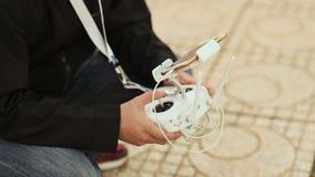 A man controls a quadrocopter through a smartphone stock video footage
