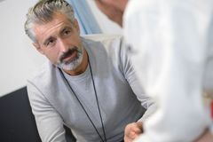 Man in conversation with doctor. Patient royalty free stock photo