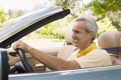 Man in convertible car smiling Stock Images