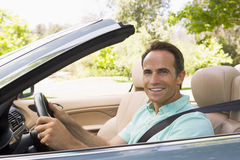 Man in convertible car smiling Stock Photography
