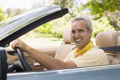 Man in convertible car smiling Stock Photo