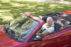 Man in convertible car smiling Stock Image