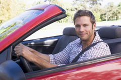 Man in convertible car smiling Royalty Free Stock Image