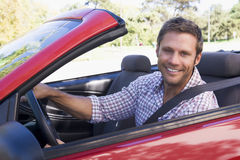 Man in convertible car smiling Royalty Free Stock Photo