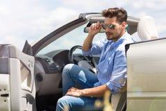 Man in convertible royalty free stock photos