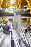 Man on the conveyor escalator at the airport.  Royalty Free Stock Images