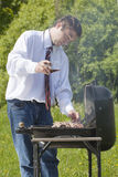 Man coocing meat. Royalty Free Stock Images