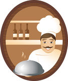 Man cook. At restaurant, the cheerful cook offers hot a dish Royalty Free Stock Photography