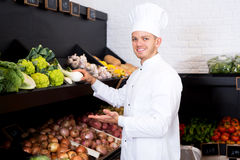 Man cook deciding on best vegetables Stock Photos