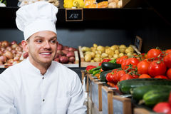 Man cook deciding on best vegetables Royalty Free Stock Photography