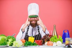 Man cook hat apron hold fresh vegetables. Vegetarian recipe concept. Vegetarian restaurant. Buy fresh vegetables grocery. Store. Hipster chief chef vegetarian royalty free stock images