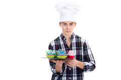 Man with cook hat and cupcake Stock Images