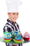 Man with cook hat and cupcake Stock Photography