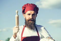 Man cook holding rolling pin Stock Image