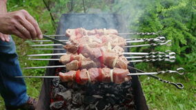 Man cook meat on skewers. stock footage