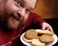 Man with Cookie. Overweight middle aged man with cookies Royalty Free Stock Photos