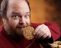 Man with Cookie. Overweight middle aged man with cookies Royalty Free Stock Images