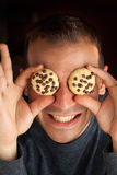 Man with Cookie Eyes Royalty Free Stock Photography
