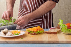 Man cooking big sandwich Royalty Free Stock Photos