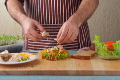 Man cooking big sandwich Royalty Free Stock Photo