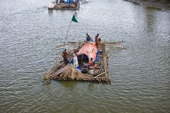 Man cooking on a boat in the river unique photo. Bangladeshi people travelling on a boat and cooking food unique editorial image stock photo