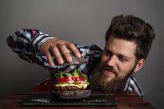 Man cooking burger Royalty Free Stock Photo
