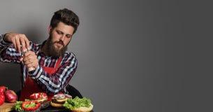 Man cooking burgers Stock Photography