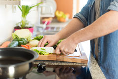 Man cooking Stock Images