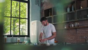 The man is cooking a dinner.  stock video footage