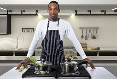 Man Cooking at a Domestic Kitchen Royalty Free Stock Photo