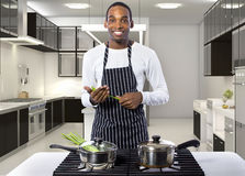 Man Cooking at a Domestic Kitchen Stock Photo