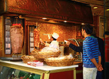 Man cooking a doner kebab at the Istiklal Street in Istanbul. Royalty Free Stock Photography