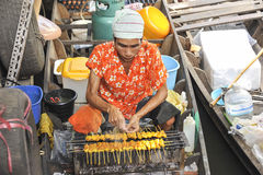 Man cooking food at the floating market in Bangkok, Thailand Royalty Free Stock Images