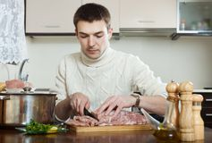Man cooking french-style meat Stock Image