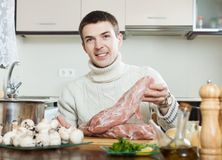 Man cooking french-style meat Stock Images