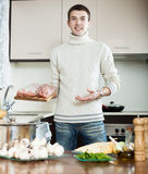 Man cooking french-style meat in roasting pan Royalty Free Stock Image