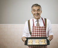 Free Man Cooking Gingerbread Men Royalty Free Stock Photos - 59081398