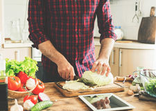 Man cooking healthy meal in the home kitchen Stock Image