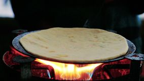 Cooking roti on the stove top.