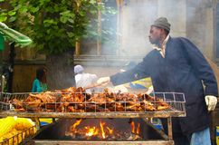 Man cooking jerk chicken at Notting Hill Carnival London stock images