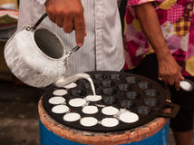 A man is cooking Kanom Krok , Dessert Thai sweet. Royalty Free Stock Image